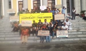 Students raise their placards in support of Mahan at Town Hall. PC: Rahulraj.S